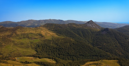 massif: Panorama in the Central Massive in Cantal region of France.In the right part there is Puy Griou 1694m and in the distance can be seen The Plomb du Cantal (1858) which is the highest point in these moutains.The Central Massif is an elevated region in south