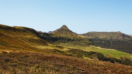 pyramid peak: View of the Puy Mary(1787m) which is the most visited summit in the Cantal Volcano in The Central Massif in Auvergne region of France.The Cantalien volcano is the largest volcano in Europe (2 700 km²) and the entire region of The Central Massif contains t Stock Photo