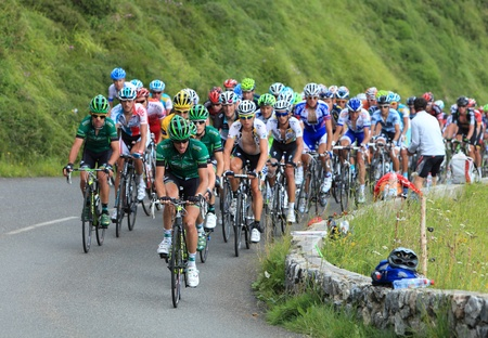 B�ost,France,July 15th 2011: Image of the peloton climbing the category H mountain pass Abisque in the 13th stage of the 2011 edition of Le Tour de France, the biggest cycling race in the world.The front of this peloton is formed by the Europcar team