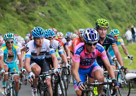 B�ost,France,July 15th 2011: Image of the peloton climbing the category H mountain pass Abisque in the 13th stage of the 2011 edition of