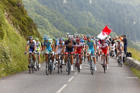 category: B�ost,France,July 15th 2011: Image of the peloton climbing the category H mountain pass Abisque in the 13th stage of the 2011 edition of