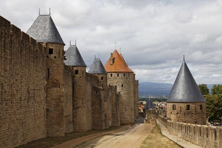 fortified: Image of wall and towers in Carcassonne fortified town in France.