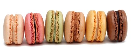 Row of colorful macarons against a white background.