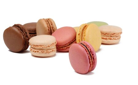 Colorful macarons against a white background.Selective focus on the pink vertical one.