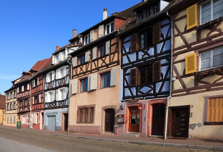 colmar: Colmar,France,May 8th 2011: Image of a street with colorful Alsatian houses located in Colmar,Alsace in north-eastern France.Colmar is an attractive commune in Haut-Rhin department in France and it is considered to be the