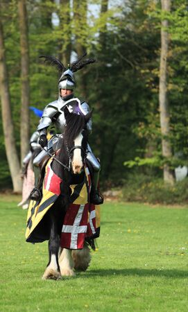 existence: Harcourt,France,April 17th 2011: Image of a medieval knight preparing for a fight during a tournament held in Harcout in France, to celebrate 1100 years of existence of Normandy..