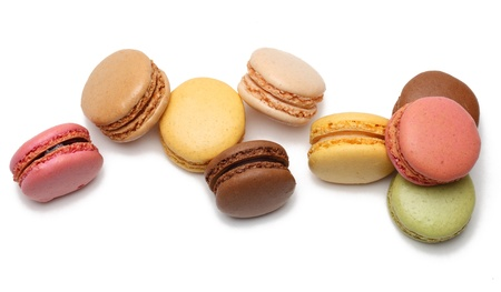 Upper view of few colorful macarons isolated against a white background.