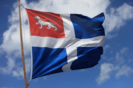 sain: Image of a medieval flag in the wind against a white background.