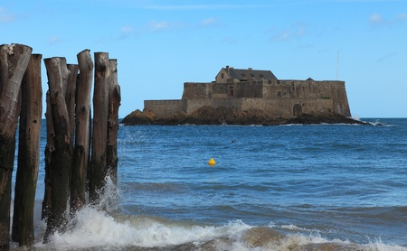 bastion: Image of The Fort National from Saint Malo,in Brittany in northwestern France, during the high tide time.The construction was used first as a reference point for the ships and from 1869 became a defensive bastion against the English attacks.