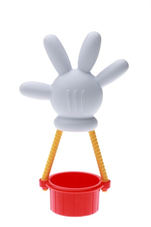 disney cartoon: Chartres,France-September 18th, 2011: Toy hot air balloon with the shape of Mickey Mouses hand isolated against a white background. This balloon is an important item in the successful childrens television series Mickey Mouse Clubhouse. Editorial