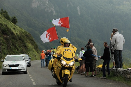 Beost,France,July 15th 2011: Image of the yellow official bike passing before the arrival of the peloton on the category H mountain pass Abisque, during the 13th stage of Le Tour de France 2011.