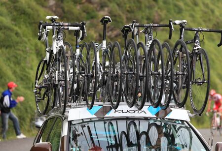 Beost,France-July 15th, 2011:Image of Kuota spare bicycles on the roof of the race car of the AG2R La Mondiale cycling team on the last kilometers of the category H mountain pass Abisque climb, during the 13th stage of Le Tour de France 2011. Stock Photo - 10666631