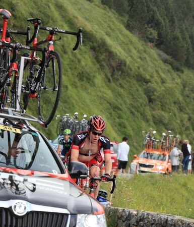 brent: Beost,France-July 15th, 2011: Image of the cyclist Bookwalter Brent (BMC Racing Team) climbing the category H mountain pass Abisque,from Pyrenees mountains in the 13th stage of the 2011 edition of Le Tour de France, close to his teams race car. Editorial