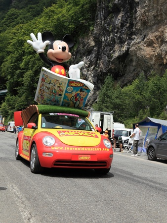 Beost,France,July 15th 2011: Mickey Mouses car during the passing of the advertising caravan on the category H climbing route to mountain pass Abisque in the 13th stage of the 2011 edition of Le Tour de France, the biggest cycling race in the world. Befo
