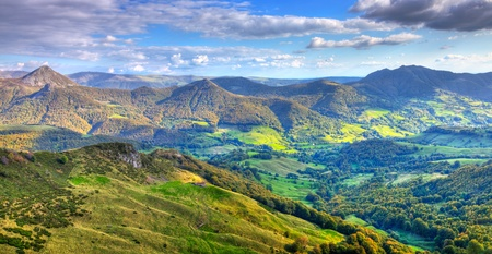 Beautiful panorama of the peaks, plateaus and valleys in Auvergne (Cantal) in The Central Massif located in south-central France.This region contains the largest concentration of extinct volcanoes in the world.