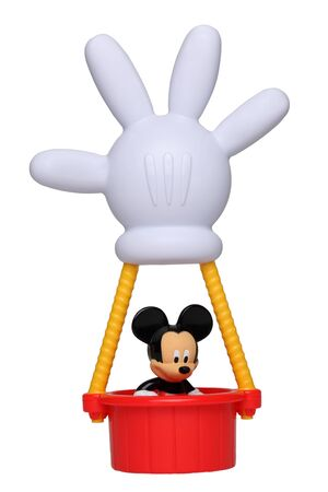 Chartres,France-September 18th, 2011: Mickey Mouse in his hot air balloon with the shape of his hand isolated against a white background. This balloon is an important item in the successful childrens television series Mickey Mouse Clubhouse.