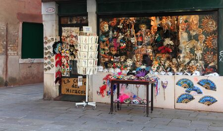 Venice,Italy- February 25th,2011: Image of a shop full of traditional masks, located in a small street in Venice. The Carnival of Venice (Carnevale di Venezia) is an annual festival, held in Venice, Italy and is now established as one of the world's most  Stock Photo - 10820386