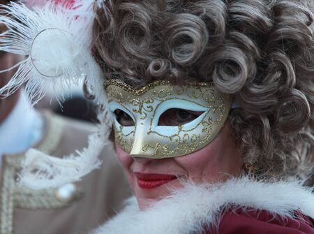 carnevale: Venice,Italy- February 26th, 2011: Portrait of a woman wearing a mask in Venice during the carnival days.The Carnival of Venice (Carnevale di Venezia) is an annual festival, held in Venice, Italy and is now established as one of the worlds most colourful