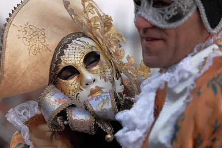 costume jewelry: Venice,Italy- Ferbruary 26th, 2011: Close up image of two light brown masks during the Canival of Venice.The Carnival of Venice (