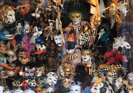 souvenirs: Venice, Italy - February 25th, 2011: Image of the masks shop window full with various types of masks in Venice. The image is through the window so there are some light distorsions. The Carnival of Venice (Carnevale di Venezia) is an annual festival, held  Editorial