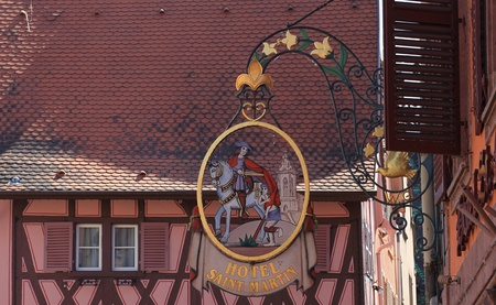Colmar,France- May 8th, 2011: Detail image of the logo of the traditional Hotel Saint Martin in Colmar,Alsace in north-eastern France.Colmar is an attractive commune in Haut-Rhin department in France and it is considered to be the Capital of Alsatian Wine
