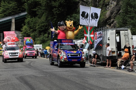 Beost,France,July 15th 2011: Haribo cars during the passing of the advertising caravan on the category H climbing route to mountain pass Abisque in the 13th stage of the 2011 edition of Le Tour de France, the biggest cycling race in the world. Before the