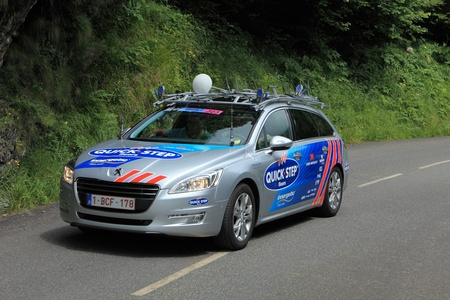 Beost,France,July 15th 2011:Image of the official car of the Quick Step cycling team on the category H climbing route to mountain pass Abisque in the 13th stage of the 2011 edition of Le Tour de France, the biggest cycling race in the world.
