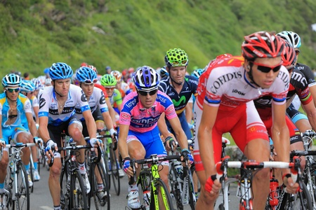 Beost,France,July 15th 2011: Image of the peloton climbing the category H mountain pass Abisque in the 13th stage of the 2011 edition of Le Tour de France, the biggest cycling race in the world.