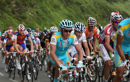 Beost,France,July 15th 2011: Close-up image of a group of cyclists in the peloton during the climbing the category H mountain pass Abisque in the 13th stage of the 2011 edition of Le Tour de France, the biggest cycling race in the world.