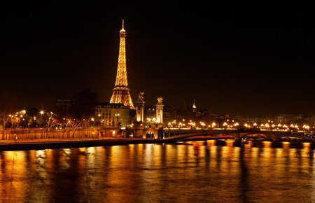 Paris,France-December 11, 2011: Night image of the Seine river and Eiffel Tower in Paris.