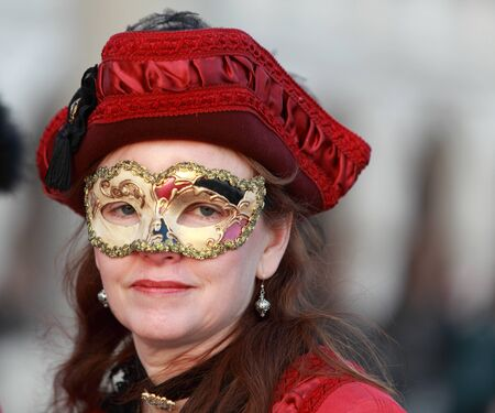 Venice,Italy- February 25th, 2011: Portrait of a woman wearing a mask in Venice during the carnival days.The Carnival of Venice (Carnevale di Venezia) is an annual festival, held in Venice, Italy and is now established as one of the world's most colourful Stock Photo - 11828166