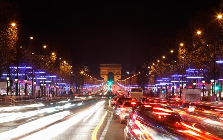 December illumination and traffic lights on the Avenue des Champs Elysees Paris,Europe.