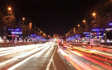 Arc de Triomphe: December illumination and traffic lights on the Avenue des Champs Elysees in Paris,Europe.