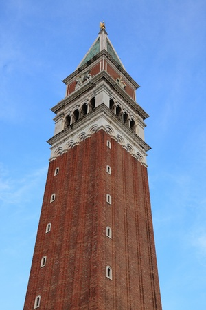 campanille: The upper part of St Marks Campanile (Campanille di San Marco) locate din St. Marco square in front of the basilica.It is one of the most recognizable symbols of the city. Stock Photo