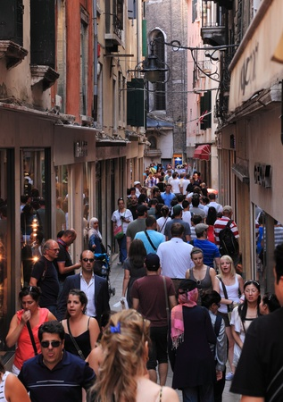 Venice,Italy- July 28th,2011: Image of a very crowded narrow street in Venice,Italy.Venice is one of the most visited city in the world with an average number of 50000 tourists in a day.