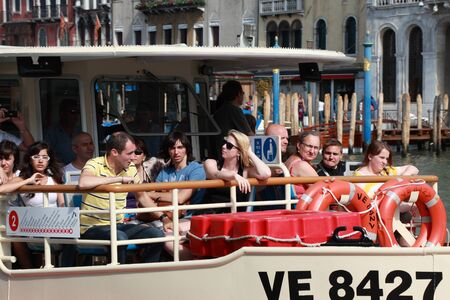 waterbus: Venice,Italy- July 28th, 2011: Image of tourists during a trip with Il Vaporeto on the Grand Canal in Venice. Il Vaporeto is a motorised waterbus which ply regular routes along the major canals and between the citys islands.