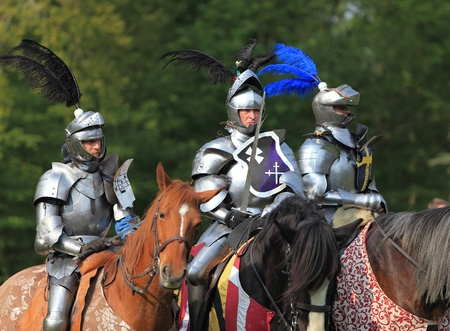 Harcourt, France- April 17th, 2011:Image of three medieval knights ready to start the fight, during a tournament held in Harcout in France, to celebrate 1100 years of existence of Normandy.