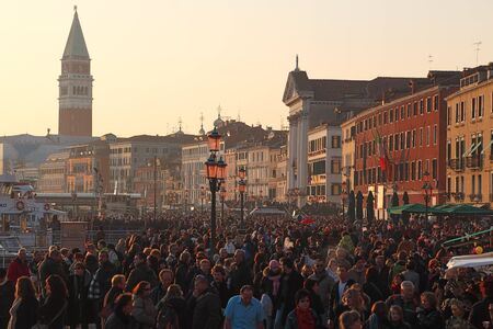 campanille: Venice, Italy- February 26th, 2011: Image of crowd of tourists walking in the evening in Sestiere Castello in Venice. Sestiere Castello (The Castello District) is the largest district in Venice and it has a special Italian atmosphere all the year long.