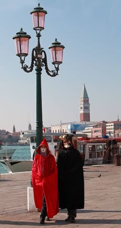 sestiere: Venice, Italy- Februray 26th, 2011: A couple of venetian tourists wearing traditional venetian costumes, walking on Sestiere Castello during the Carnival days..The Carnival of Venice (Carnevale di Venezia) is an annual festival, held in Venice, Italy and