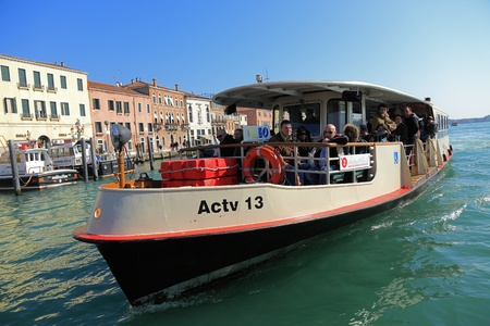 waterbus: Venice,Italy- February 26th, 2011:  Image of Il Vaporeto with tourists sailing on the Grand Canal in Venice. Il Vaporeto is a motorised waterbus which ply regular routes along the major canals and between the citys islands.