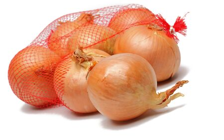 Image of onions getting out from a broken net bag, against a white background.