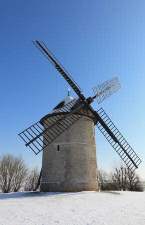 eolian: Traditional French windmill during the winter season. Stock Photo