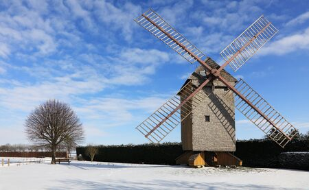 eolian: Countryside landscape with traditional windmill during the winter, located in the central part of France.