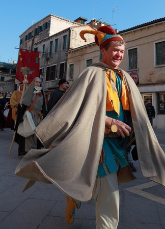 Venice,Italy- February 26th,2011: A joyful medieval buffoon jumps in the street in a characters parade in Venice during the Carnival days.The Carnival of Venice (Carnevale di Venezia) is an annual festival, held in Venice, Italy and is now established as