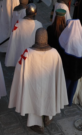 templars: Venice,Italy-February 26th, 2011: People disguised in templar knights marching in a costume parade on Sestiere Castello in Venice during the Carnival days.