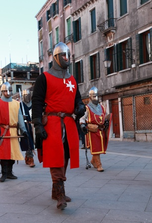 templars: Venice,Italy-Februray 26th, 2011: Image of a medieval army marching in a characters parade in Venice on Sestiere Castello, during The Canival days.The Carnival of Venice (Carnevale di Venezia) is an annual festival, held in Venice, Italy and is now establ
