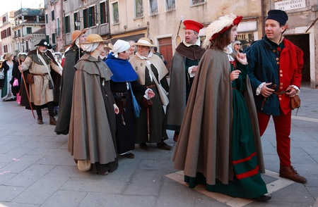 sestiere: Venice, Italy- February 26th, 2011: People wearing specific medieval clothes participating in a costumes parade on Sestiere Castello during the Venice Carnival days. The Carnival of Venice (Carnevale di Venezia) is an annual festival, held in Venice, Ital Editorial