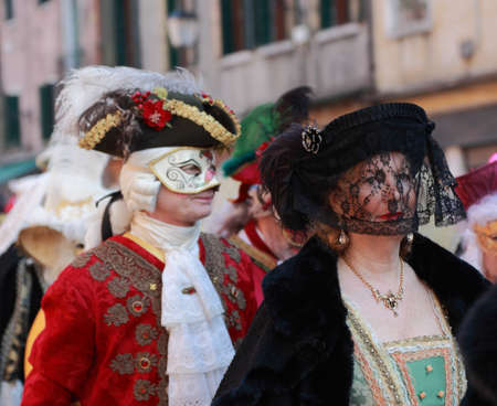 sestiere: Venice,Italy- February 26th, 2011: Disguised mature woman participate in a costumes parade on Sestiere Castello during the Venice Carnival days.The Carnival of Venice (Carnevale di Venezia) is an annual festival, held in Venice, Italy and is now establish