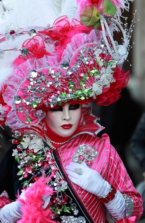 costume jewelry: Venice,Italy- February 26th, 2011: Image of a person disguised in a sophisticate costume during the Venice Carnival.The Carnival of Venice (Carnevale di Venezia) is an annual festival, held in Venice, Italy and is now established as one of the worlds mos