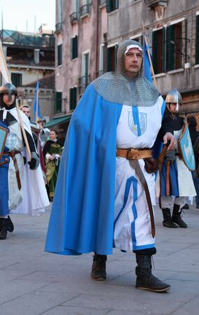 Venice,Italy-February 26th, 2011: Medieval warrior marching in a costumes parade in Venice during the Carnival days.The Carnival of Venice (Carnevale di Venezia) is an annual festival, held in Venice, Italy and is now established as one of the world's mos Stock Photo - 12257578